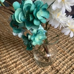 Blue teal flower with clear vase
